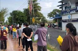 Fake news on social media about travel permit applications sends droves of people to Sibu police stations