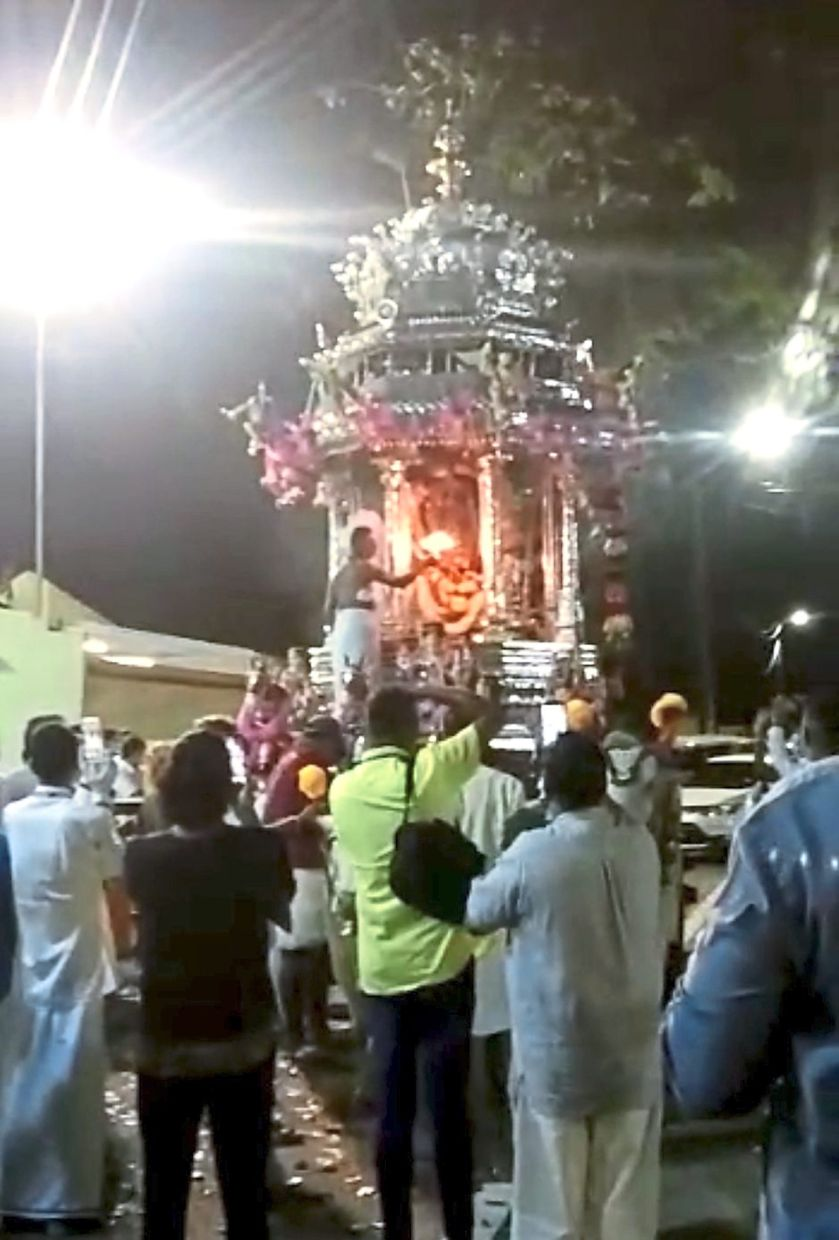 Quick journey: The silver chariot arriving at the Nattukotai Chettiar Temple in Waterfall Road, George Town.