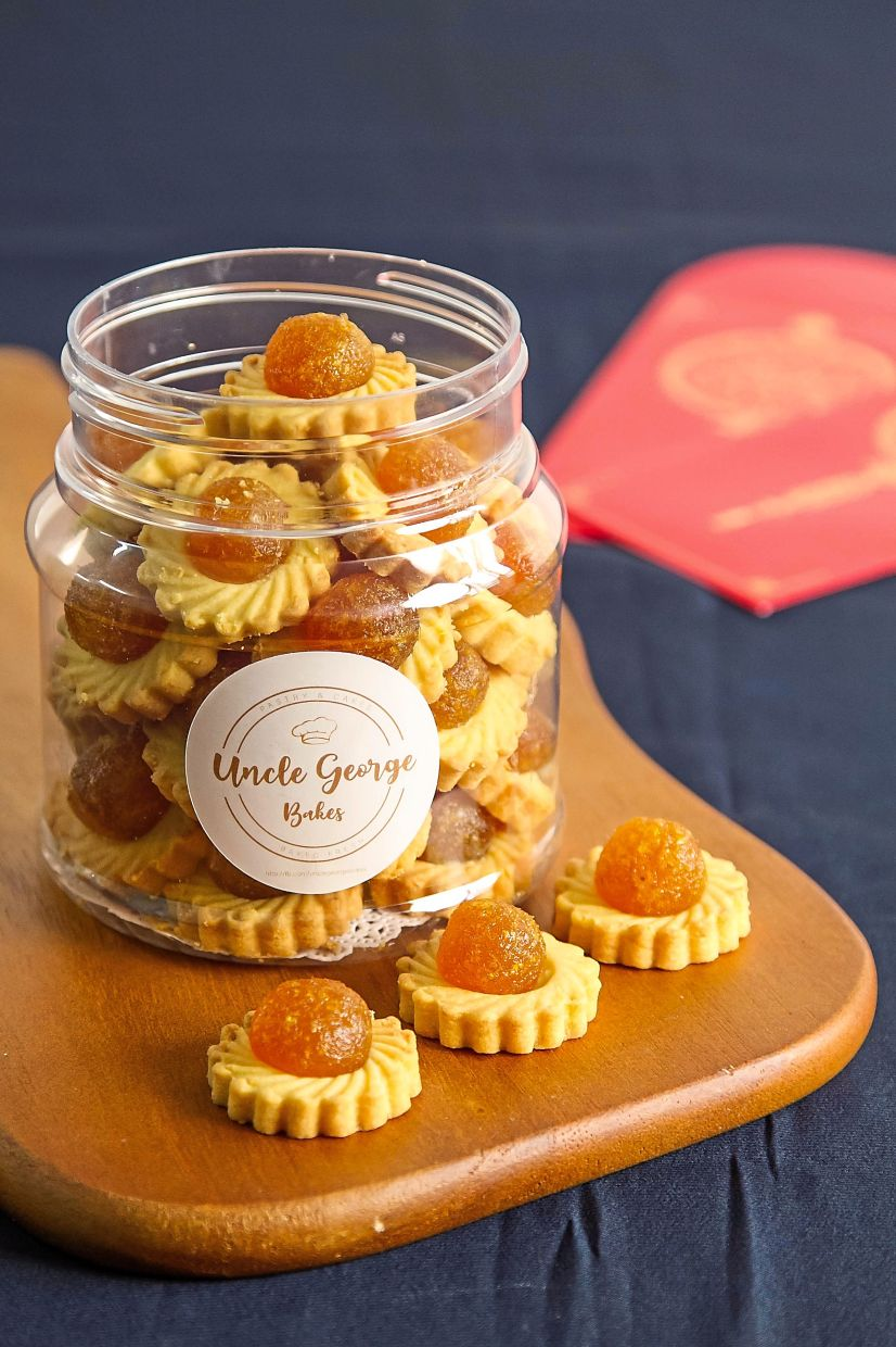 Uncle George Bakes' latest offerings are Chinese New Year cookies and pastries, including his signature pineapple tarts, prawn rolls and chocolate chip walnut cookies