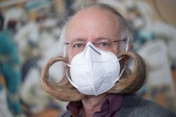 World beard champion has face mask tailored to his giant mutton chops