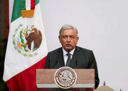 Mexican president progressing well with minor symptoms after COVID-19 diagnosis, minister says