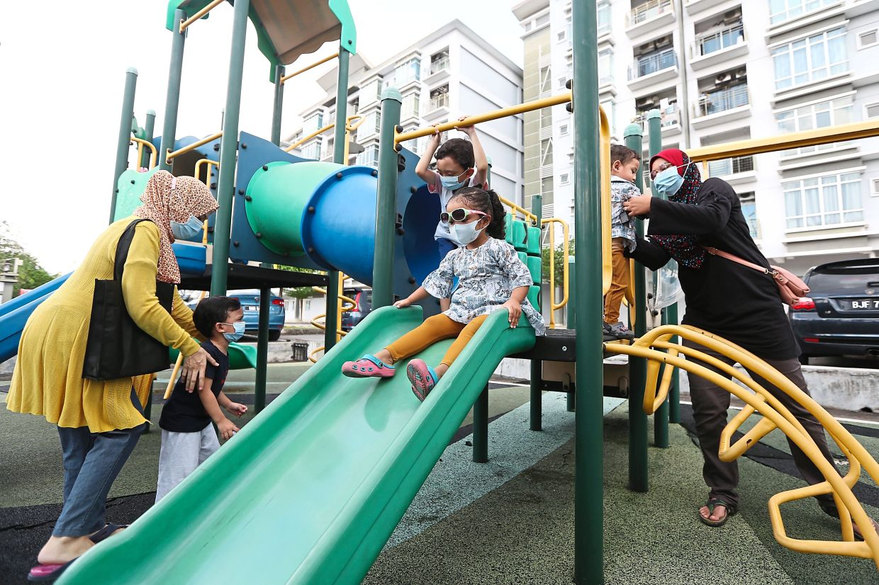 Pandemic pods allow young children to play together without the need for physical distancing. — IZZRAFIQ ALIAS/The Star