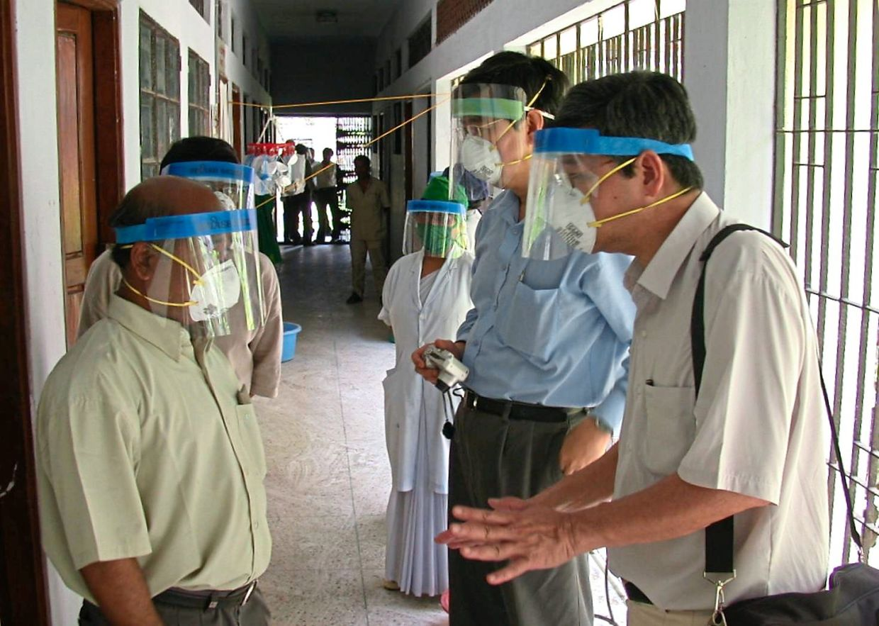 Dr Chua (second from right), along with consultant neurologist Emeritus Prof Datuk Dr Tan Chong Tin (right), served as WHO consultants during the 2004 NiV outbreak in Bangladesh. — UMMC