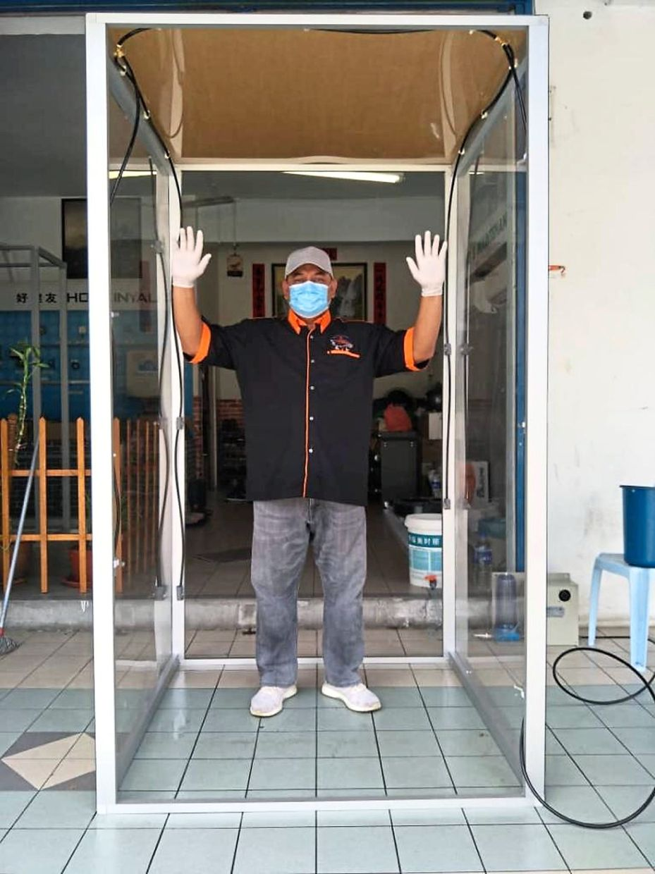 Norazam helps to build automated disinfectant walk-through gates for SMEs.