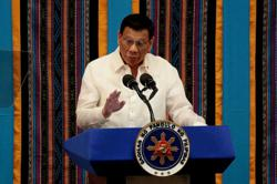 Philippines' Duterte tightens anti-money laundering rules to avoid `grey list'