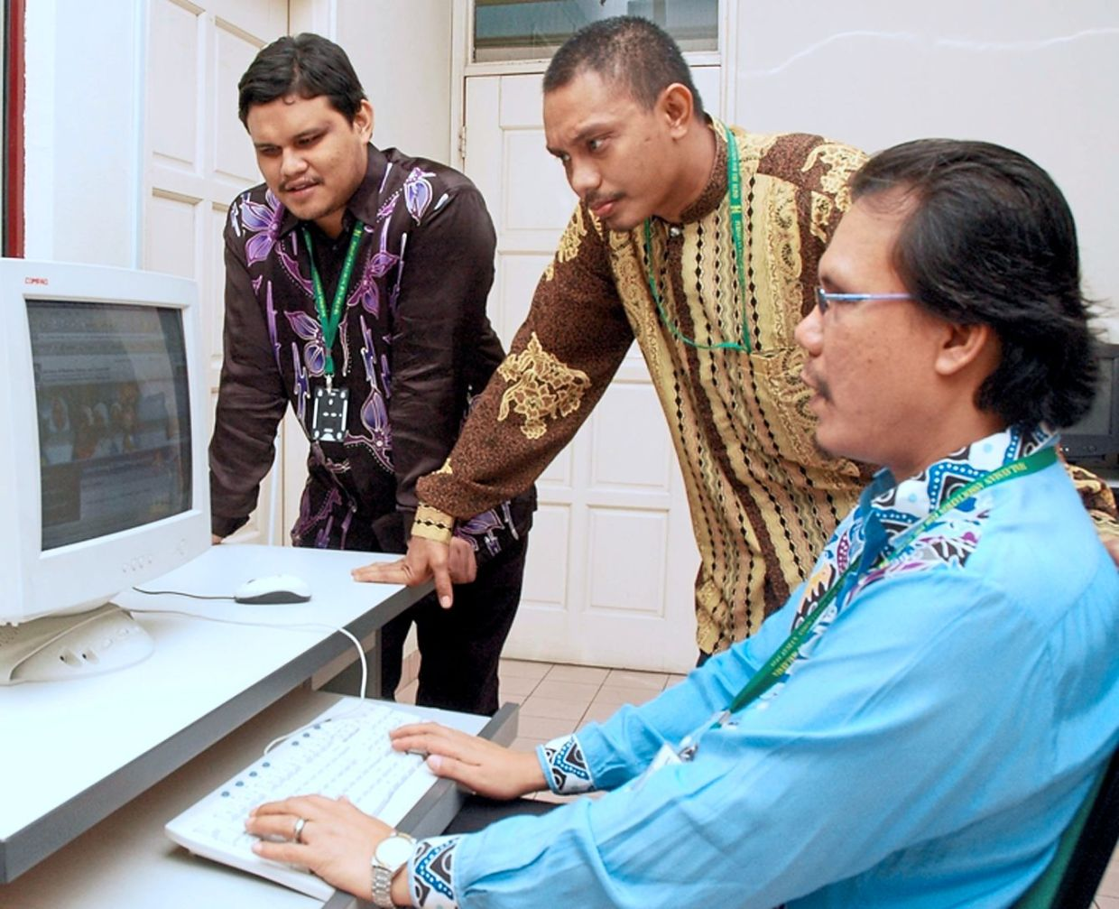 Useful tool: In this file photo taken before the Covid-19 pandemic, Silatulrahim demonstrates how to use a website that is accessible to visually impaired persons.