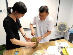 Malaysian shows off his durian-opening skills