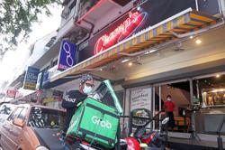 Grab upsizes debut term loan to US$2b