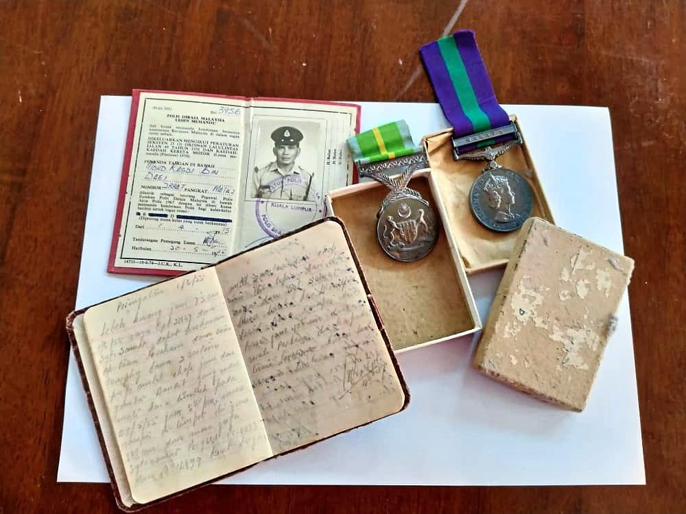 Medals for bravery and service, a diary and service card, a small legacy from his father that the columnist treasures.
