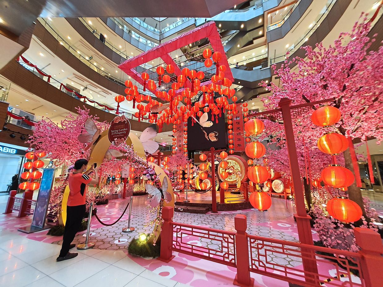 Gurney Plaza's Spring Garden of Prosperity is filled with cherry blossom trees, butterflies, lanterns and drums.
