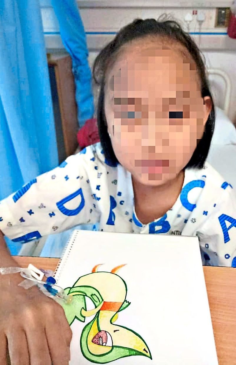 Belle cheers herself up by drawing when she is hospitalised. Photo: Angie Lim