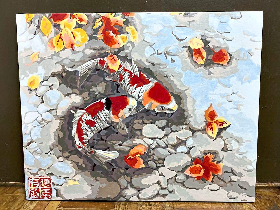 One of Belle's works of koi fish, symbolising prosperity and good fortune, which was recently sold. Photo: Angie Lim