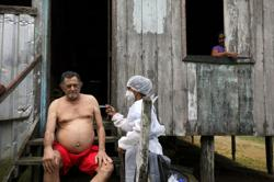 'We've lost so many': Brazil starts vaccinating Amazon river dwellers