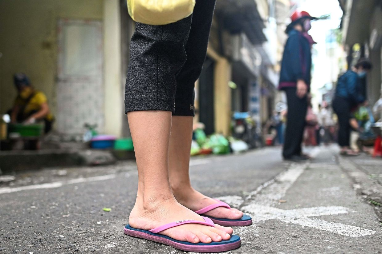 Flip-flops pose a hazard because they change the way you walk and they rarely have a secure gripping surface. — AFP