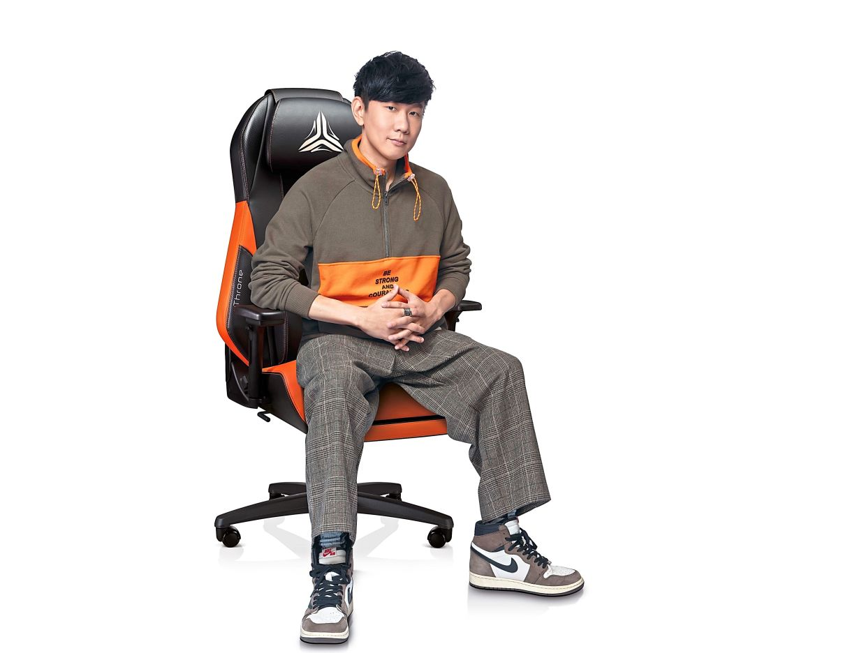 Mandopop musician JJ Lin, who now is also pursuing eSports, is collaborating with Osim on its uThrone chair, made to match the team's black and orange colours. — Osim