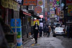 Korea eases social distancing rules as virus cases drop