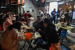 Covid-19 may have spread in Wuhan seafood market, but originated elsewhere, says WHO expert