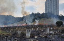 Firemen still battling blaze at Batu Lanchang Chinese cemetery