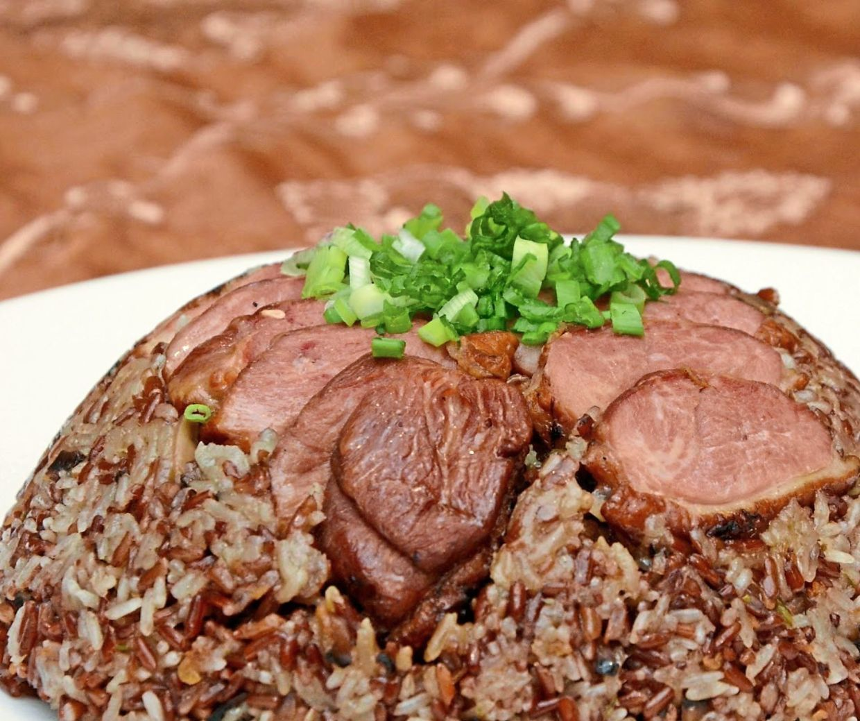 Steamed Organic Brown Rice with Glutinous Rice and Smoked Duck is included in the Prosperity Set Menu and Health Set Menu, both for groups of six.