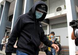 Ex-civil servant pleads guilty to two corruption charges