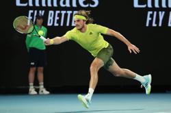 Tennis-Tsitsipas thrashes Simon to canter into second round