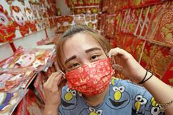 Red face masks selling well but red packets not so