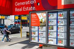 NZ clamps down on property investors as prices soar