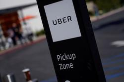 Uber reduces losses on food delivery expansion, modest uptick in ride bookings