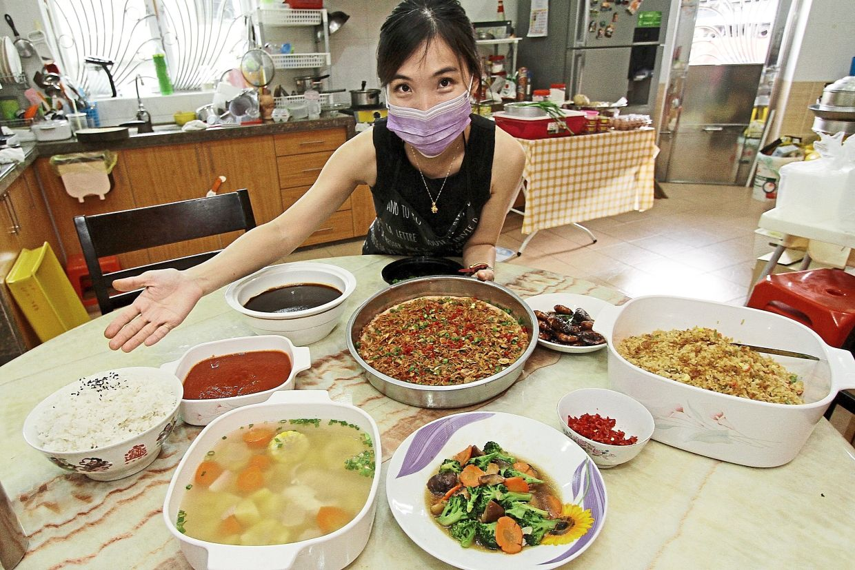 Lee showing her yam cake (middle) along with other dishes she prepared.