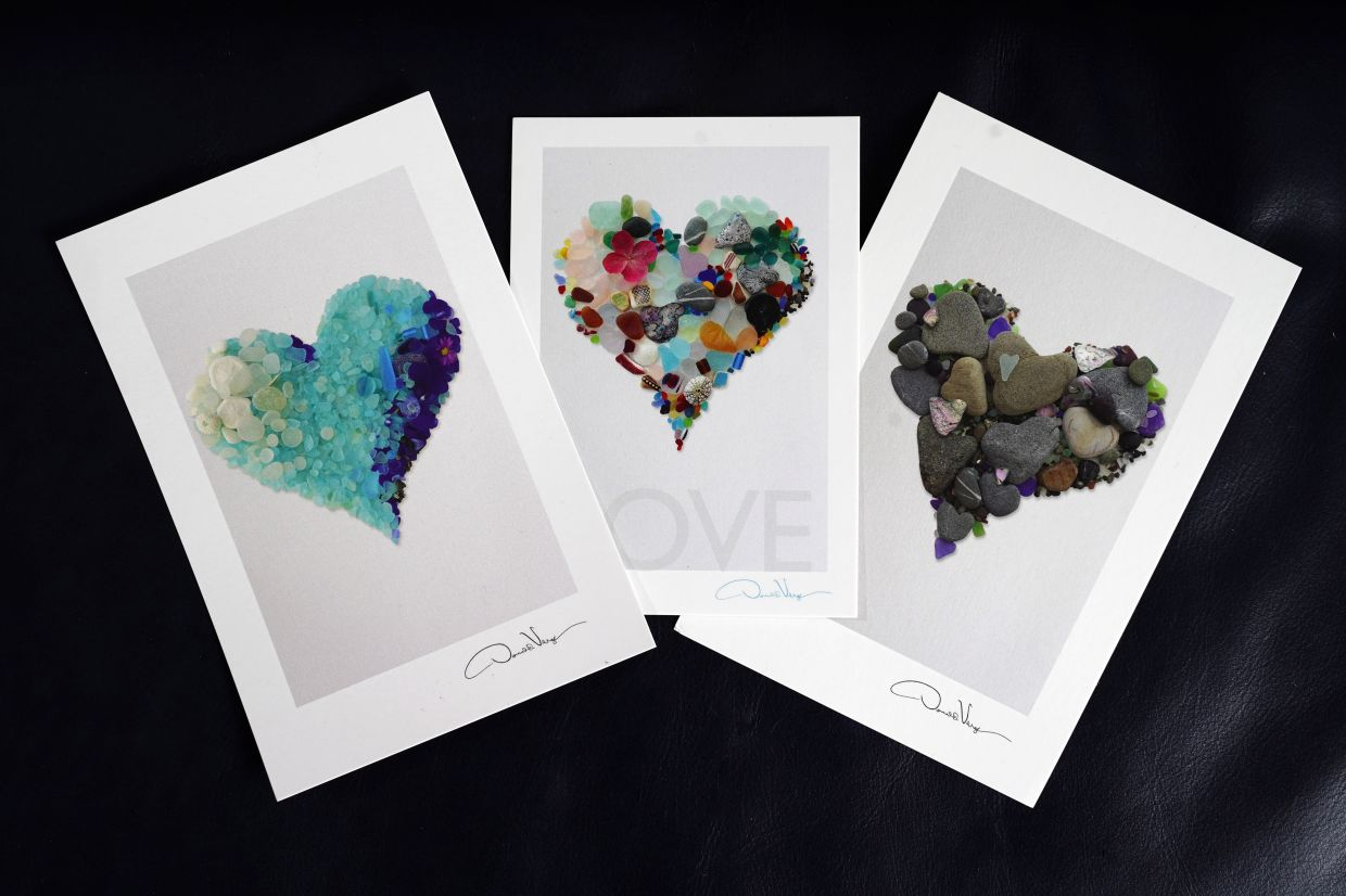 Cards with images of sea glass arrangements made by Verger. Photo: AP