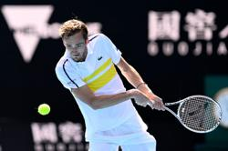 Medvedev wins five-setter to join Russian charge