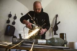 Serbian artist turns guns, helmets and missiles into music instruments