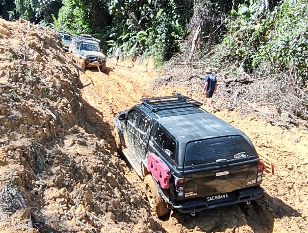 Dedication knows no boundaries: Sabah-based teacher Franky Collin Kulam braves the rough road conditions to SK Buayan, 30 km from Penampang to send learning modules to his students in a rural school. – Photo: Franky Collin Kulam