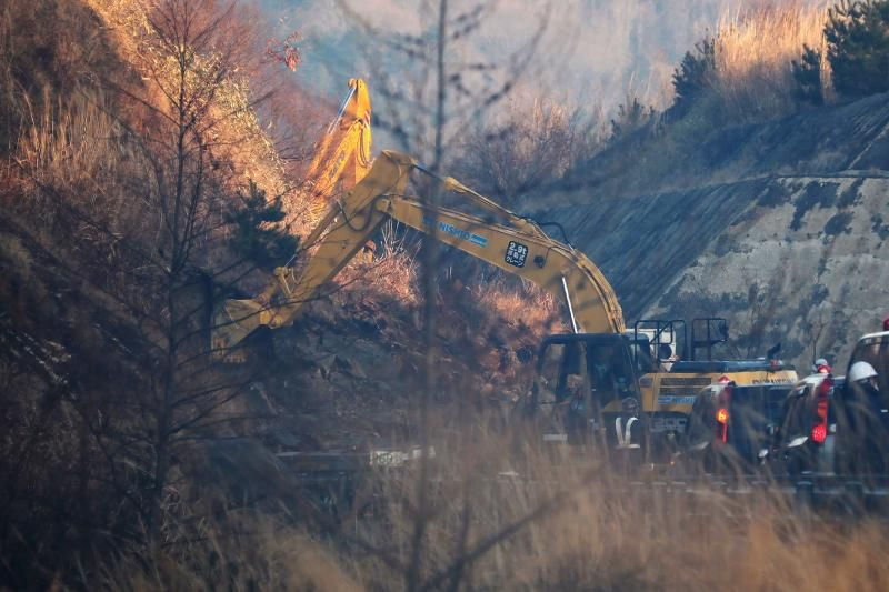 This picture shows a power excavator heavy equipment for restoration work at the landslide site on the Joban Expressway in Soma, Fukushima prefecture on February 14, 2021, following an earthquake. - AFP