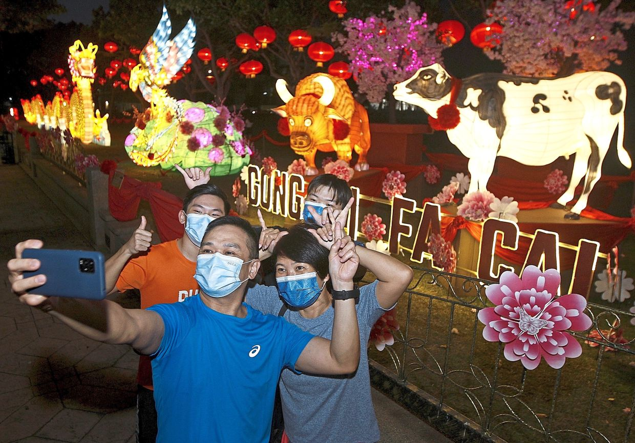 Eddy Kwan, 51, taking a wefie with his family.