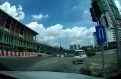 Senior citizen accidentally runs red light, causes accident