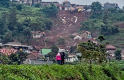 20 missing as landslide buries houses in Indonesia's East Java