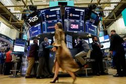 Stimulus hopes drive Dow to record closing but interest rate worries loom