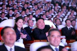 Wife of North Korean leader Kim makes first public appearance in a year