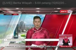 It's a samfu, just the wrong size: RTM explains newscaster's 'cheongsam'