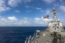 US ship sails by China-claimed islands in South China Sea