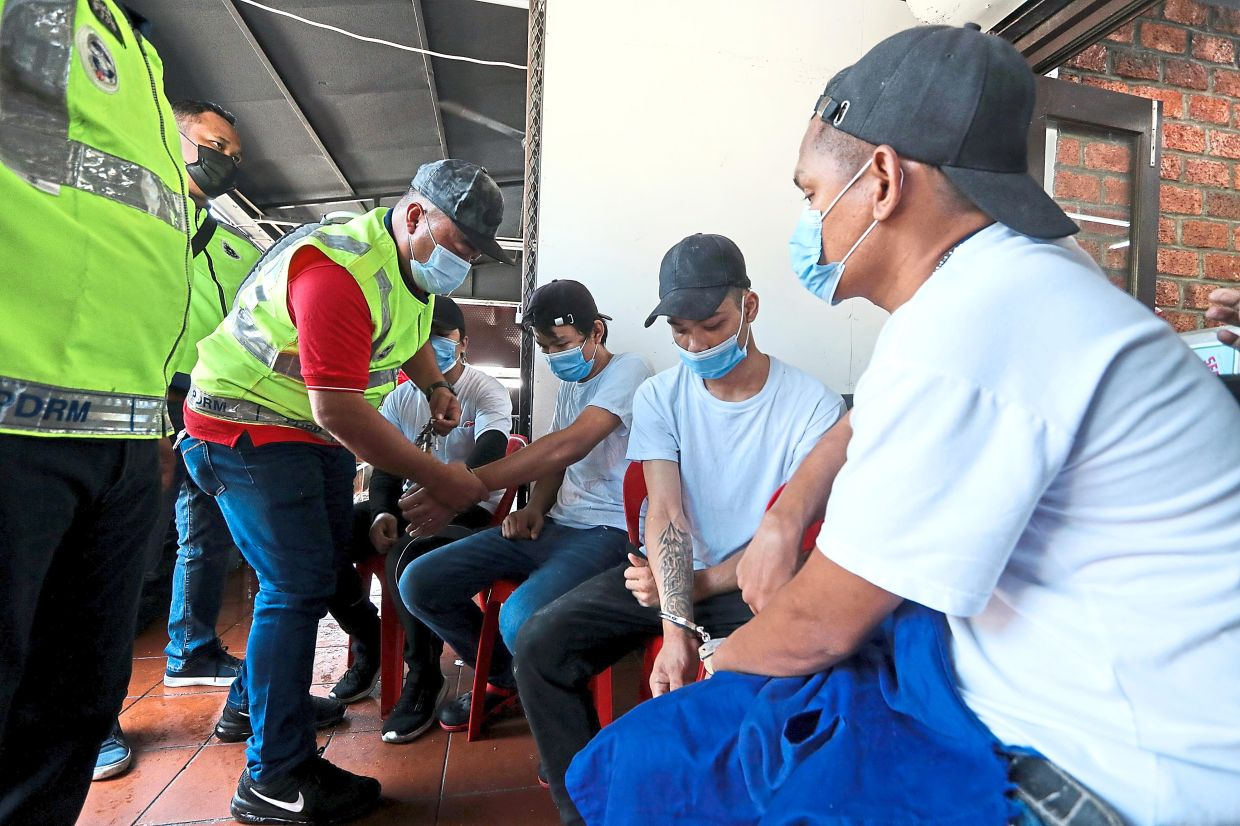 Enforcement officers detaining the foreign workers for not having valid travel documents at the restaurant in Butterworth.