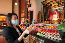 Prayers, eggs and more to mark Snake Temple deity's birthday