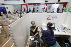 Singapore residents aged 60-69 to get Covid-19 vaccine from March, rest of population from April