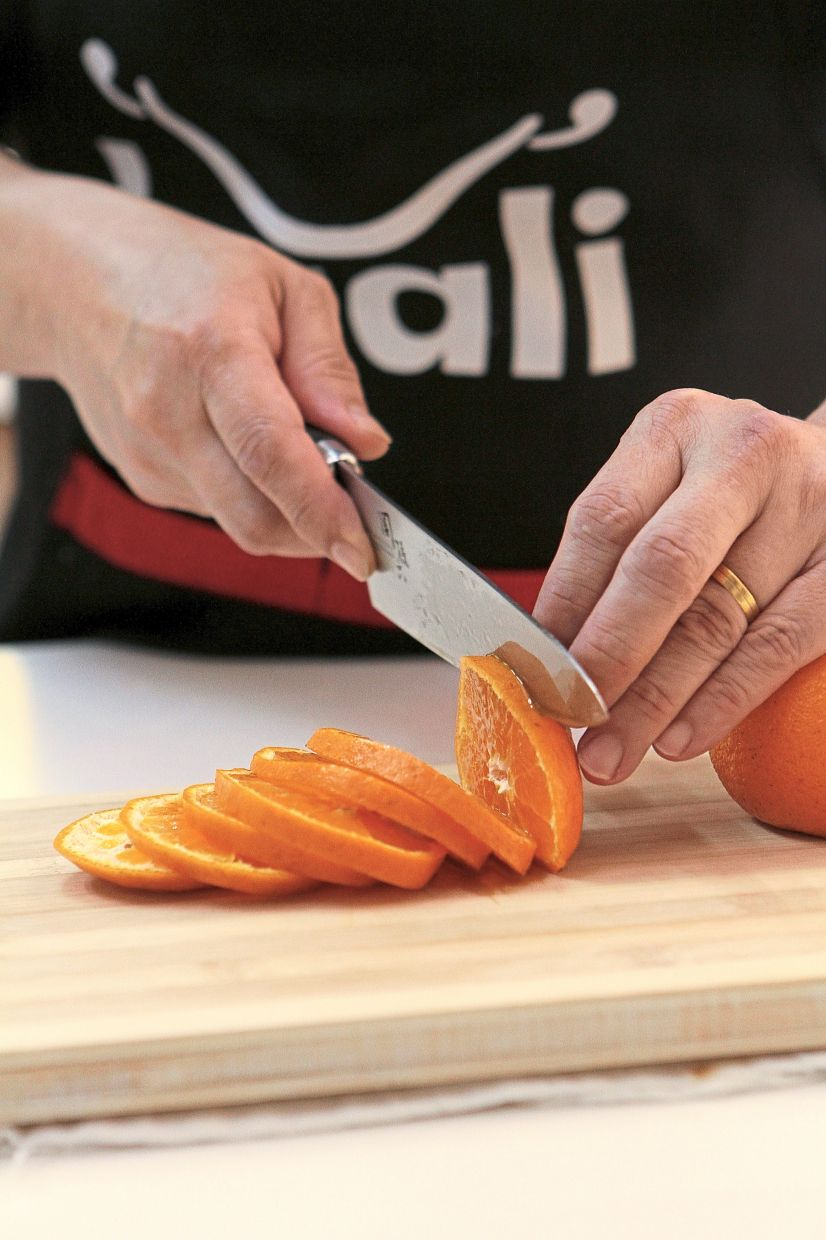 Slice oranges into 5mm thick discs for the topping.