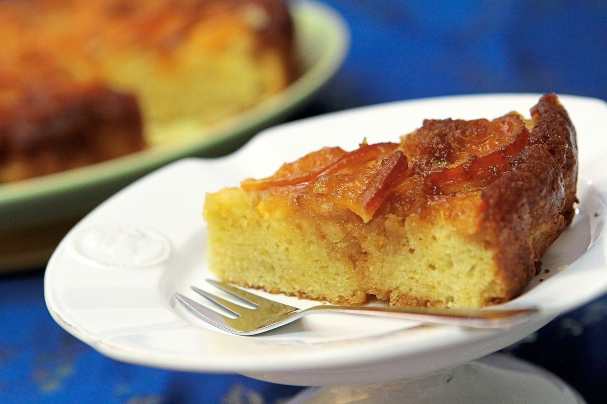 An upside-down cake is basically cake batter that is baked with its toppings on the bottom of the tin, then inverted and served right-side up.