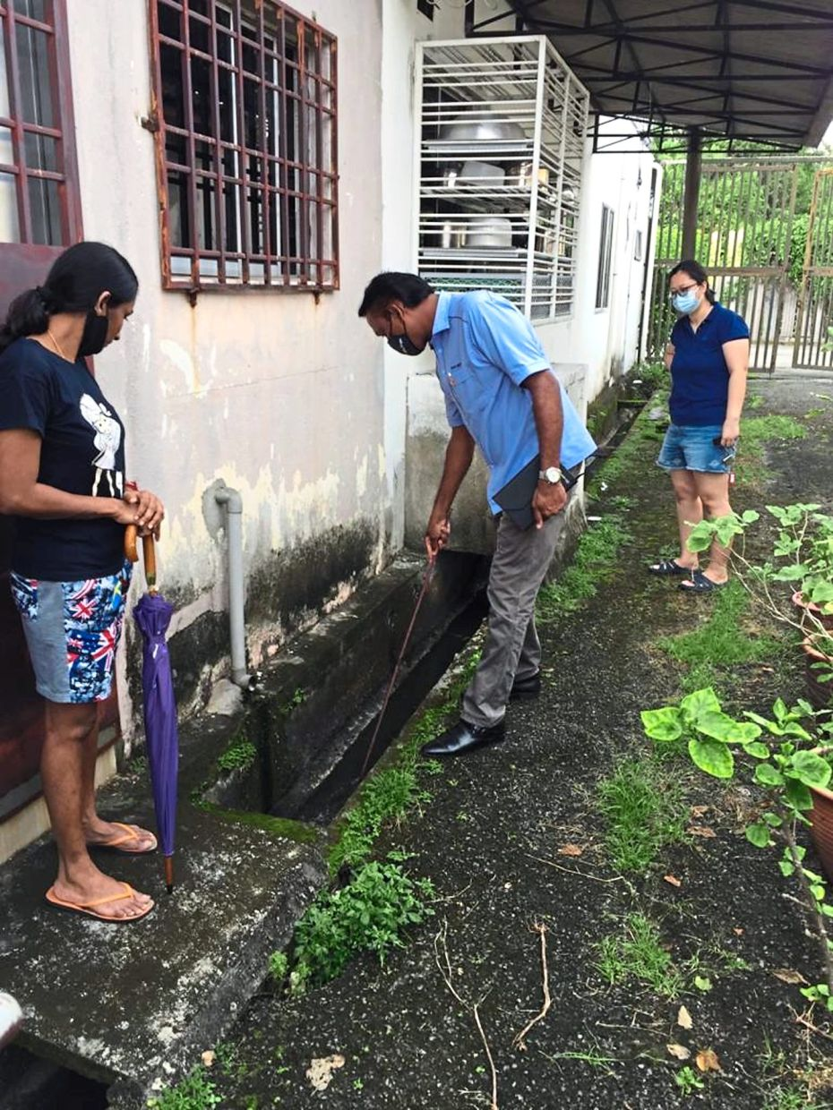 Prabu checking drains on receiving complaints of mosquitoes breeding.