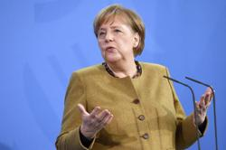Pandemic will not end until world is vaccinated, Merkel says