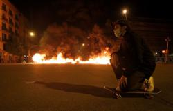 Rubbish bins set on fire, banks attacked in riots over jailed Spanish rapper