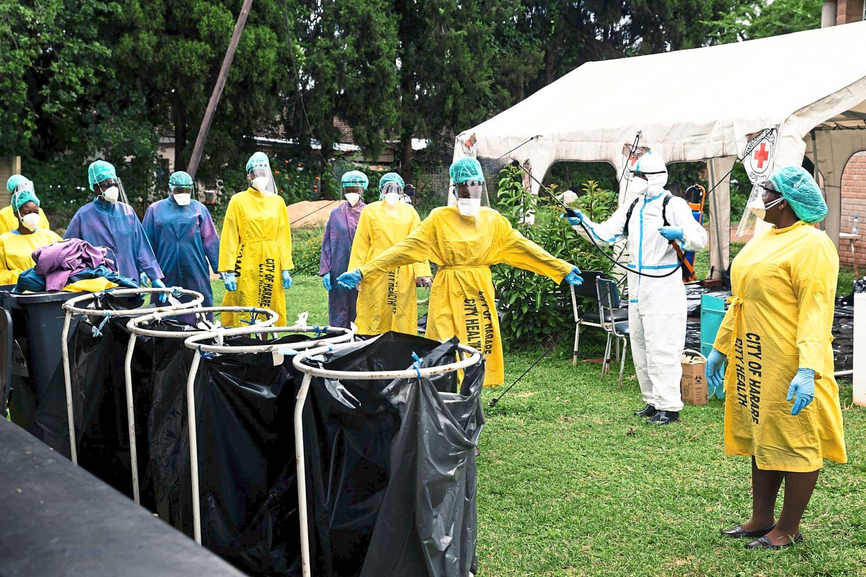 Zimbabwe health workers getting ready for their vaccination programme after receiving a donation of 200,000 doses of the Sinopharm Covid-19 vaccine from China. — AFP